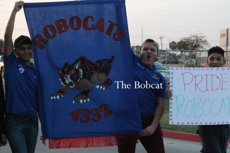 Robotics club shows their school pride during the homecoming parade.