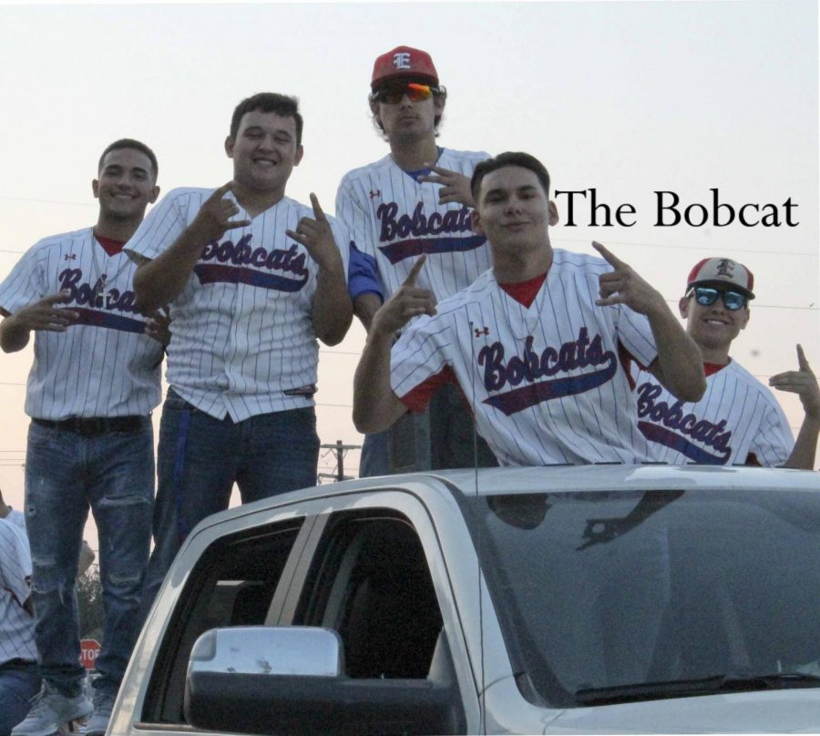 Varsity baseball poses for the camera on their homecoming float.