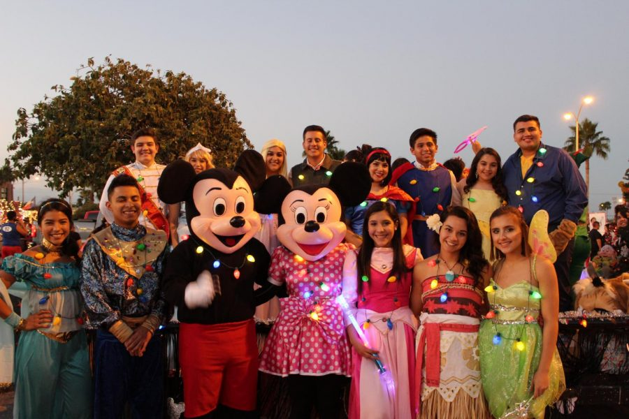 NHS and Key Club members dressed as Disney characters for the Night of Lights parade.