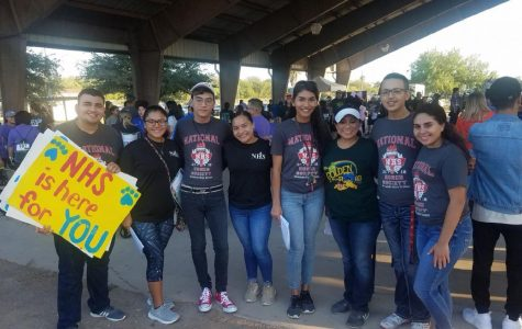 NHS members gather with the organizer of the event.