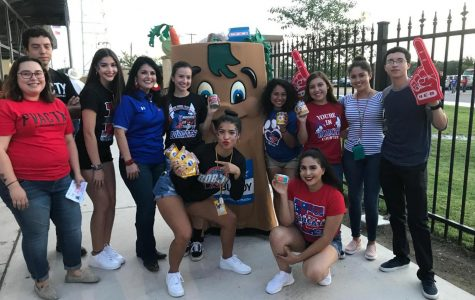Student council members and Principal Molina, stand with HEB personnel as they donate the collected cans.