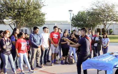 Senior Matthew Anaya sings a worship song for his peers during See You at the Pole.