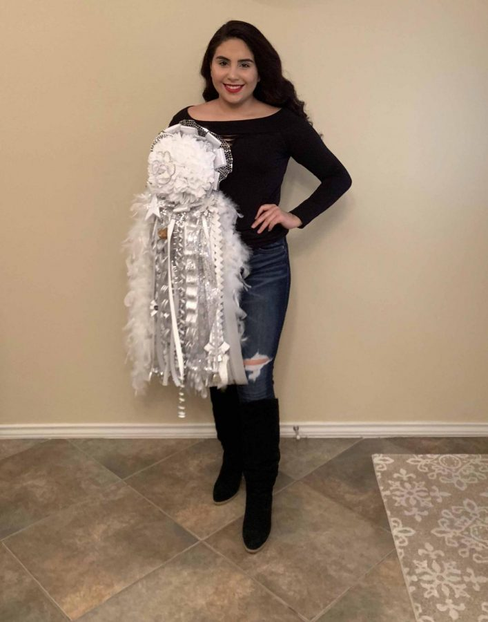 For her senior year, Xochitl Rodriguez chose a white mum for Homecoming.