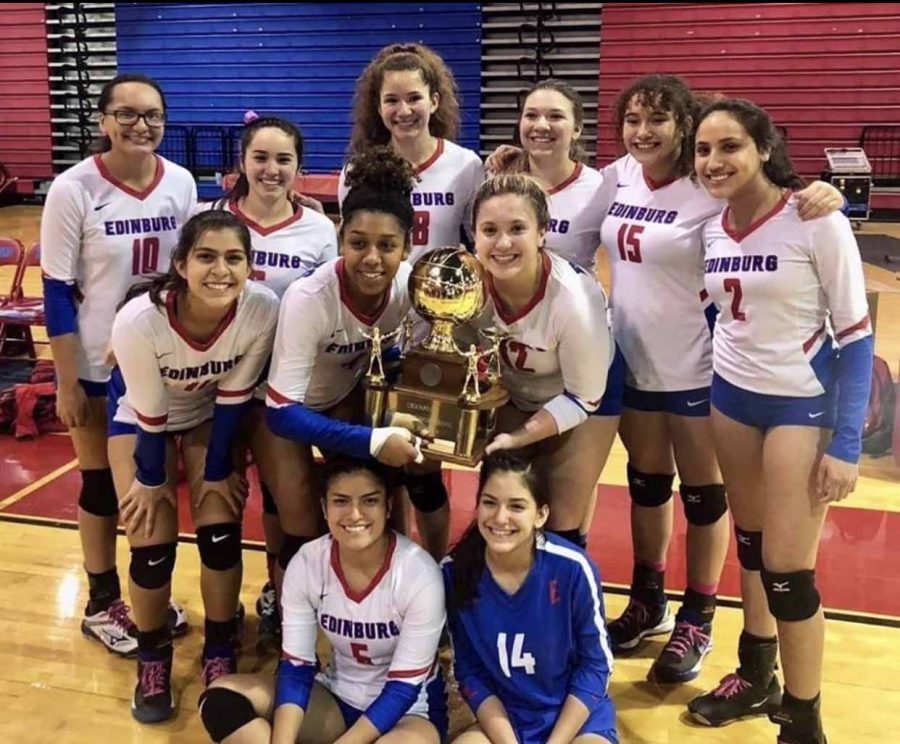 Varsity Volleyball team earns District title.