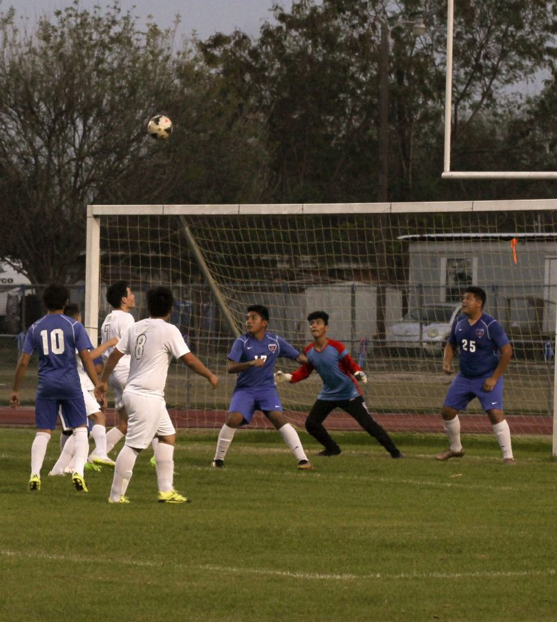 Junior Oscar Aremendariz watches the ball in preparation of what to do next.