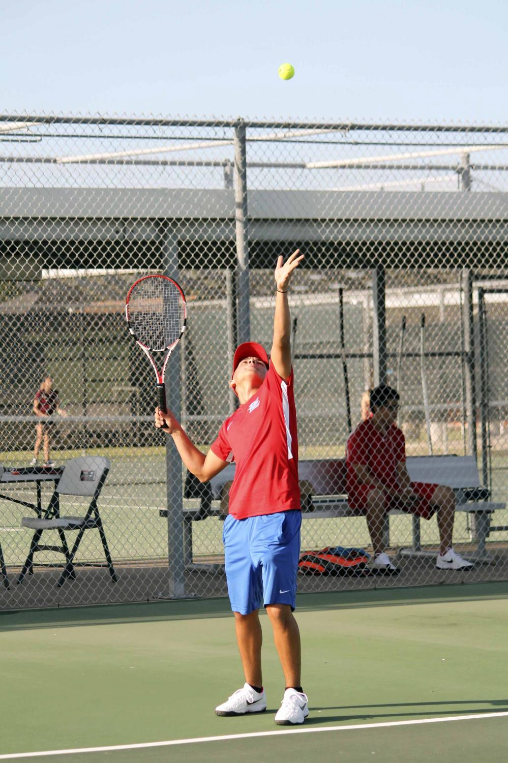 Junior Ricardo Cano serves  during the match against Donna North.