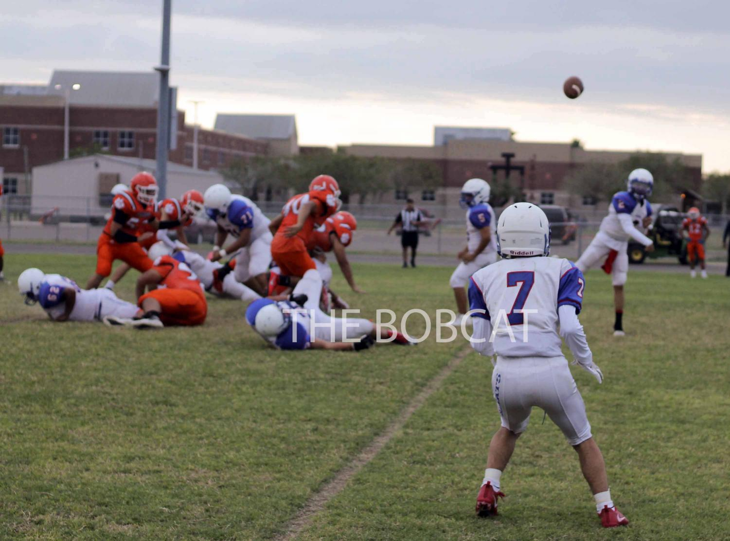 Freshman Raul Ramirez gets in position to receive the ball from the quarterback to make the play against Economedes.