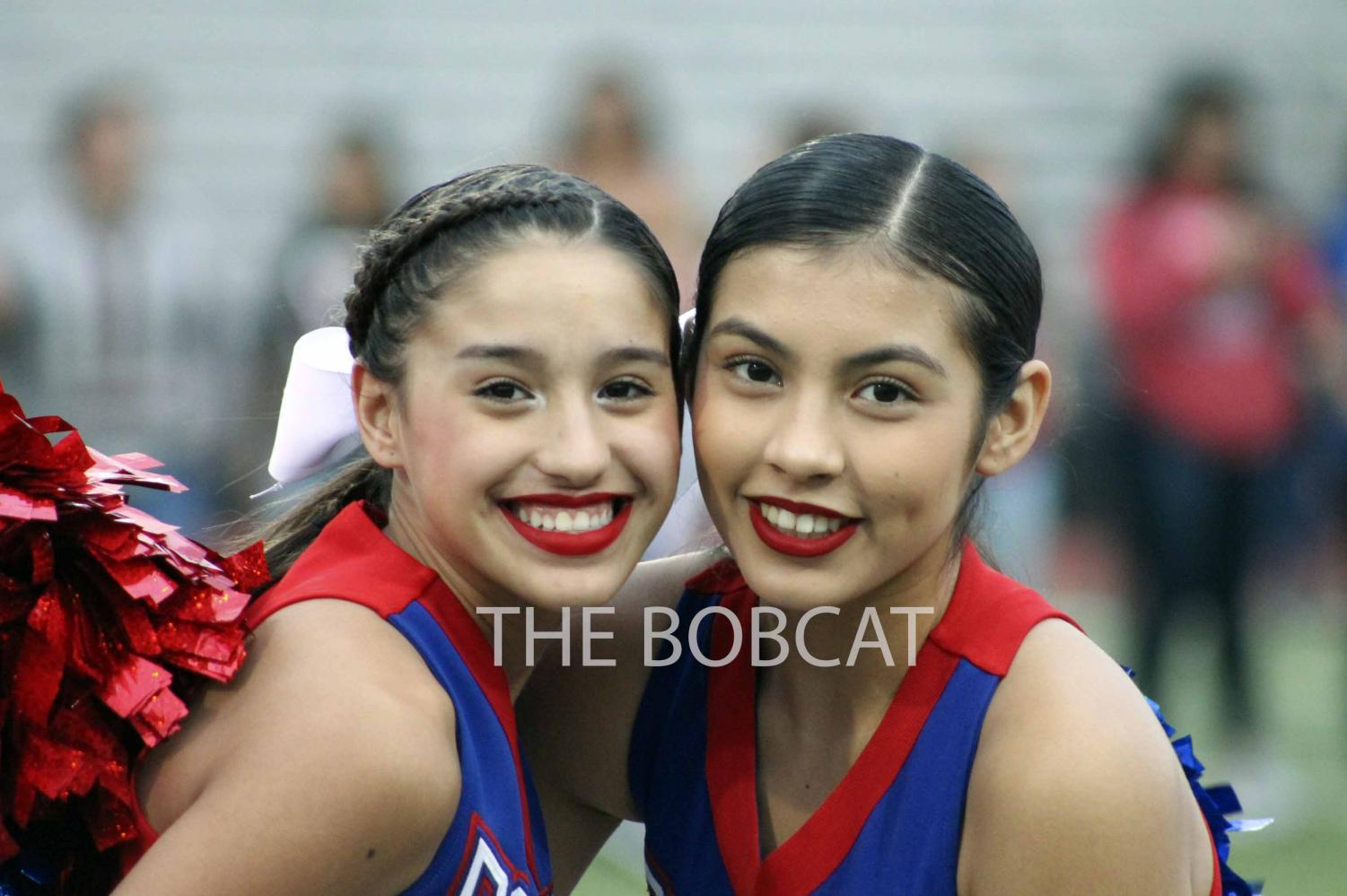 Freshman and Sophomore Cheerleaders, Lauren Perez and Angel Ponce participate in the 'Welcome' cheer at Fields of Faith.