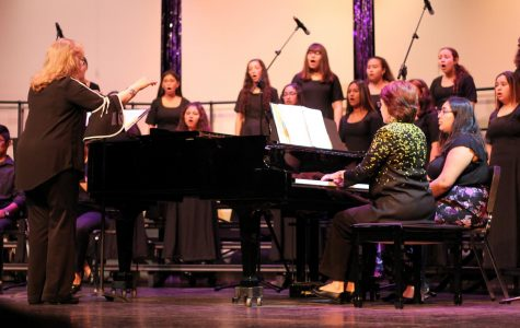 Choir Director, Mrs. Guerra directs the choir during their Fall Concert.