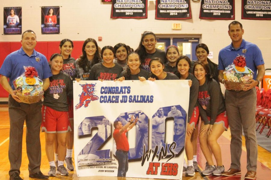 Girls+Basketball+Coach%2C+JD+Salinas+stands+with+his+team+after+being+awarded+for+his+200th+win.