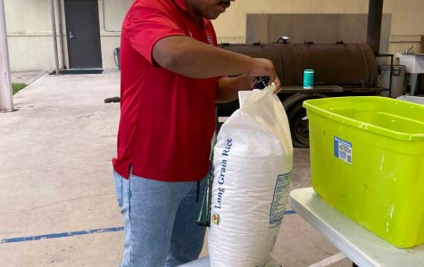 Josue Alvarez begins to prepare food bags for people in the community. First Baptist Church hosts 'Providing Hope' once a month.