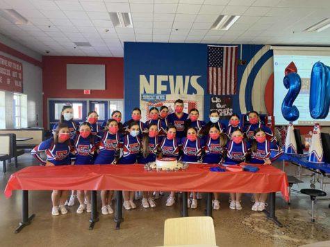Cheer team celebrates their championship title win.