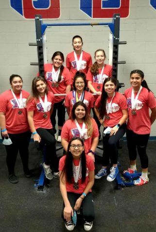 Girls powerlifters qualify for Regional competition.