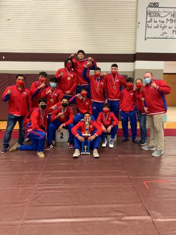 Boys wrestlers are District champions.